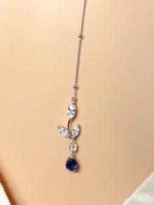 Collier de dos avec bijou de dos bleu saphir