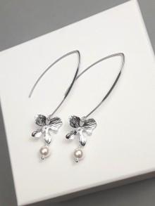 Longues boucles d'oreilles mariage fleurs orchidées