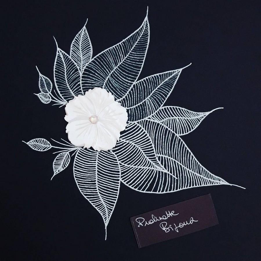 Dessin envolée de feuilles autour de la nacre